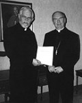 Father Robert Wild presenting the petition for the Cause to Bishop Brendan O'Brien.