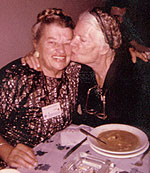 Dorothy Day gives a kiss to Catherine Doherty, Rome, 1957.
