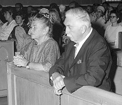 Catherine and Eddie Doherty at prayer with the community.