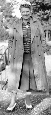 Catherine Doherty in long coat.