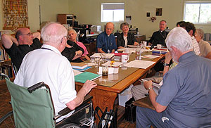 The committee at work under Fr. Tache's direction.